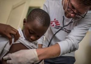 5 year old Ebola survivor Hassan Sillah in a checkup with doctor Jostein Heggeboe in the MSF survivor clinic in Freetown. As Sierra Leone prepares to become officially Ebola-free tomorrow, many survivors are still suffering from physical, social and psychological problems long after beating the virus. Freetown, Sierra Leone, 6/11/2015.